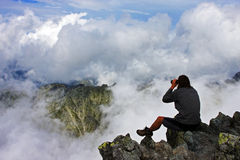 Watching the mountain crests from the top of a peak Royalty Free Stock Image