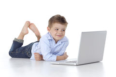 Child looks at the computer Royalty Free Stock Photography