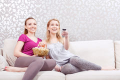 Watching movie at pajamas party Stock Images