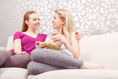 Watching movie at pajamas party Royalty Free Stock Images