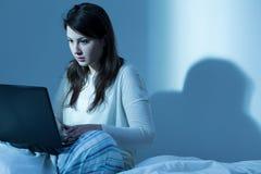 Watching movies on laptop Stock Image