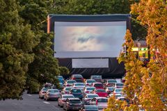 Watching movies in the open air in a car park in the city in the Stock Images