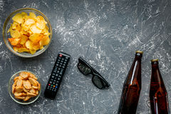 Watching movies set with chips on dark background top view mock up Stock Photos