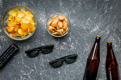 Watching movies set with chips on dark background top view mock up Stock Image