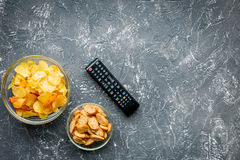 Watching movies set with chips on dark background top view mock up Royalty Free Stock Photo