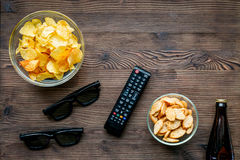 Watching movies set with chips on wooden background top view mock up Stock Images