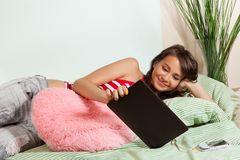 Watching movies from tablet computer Royalty Free Stock Image