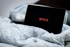 Netflix on bed stock photos
