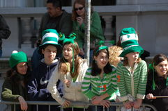 Watching New York's St. Patrick's Day Parade. Parade watchers dressed in green for the Saint Patrick's Day Parade in New York City Royalty Free Stock Photos
