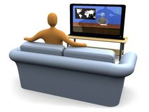 Watching The News. Person sitting on a sofa watching the news on a plasma tv Stock Photography