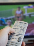 Watching olympic games on tv stock photos