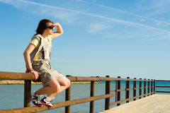 Watching out for the future. Teen looking towards the horizont, a concept Stock Photography