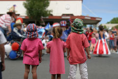 Watching the Parade. Three children watching a 4th of July parade on San Juan Island stock images