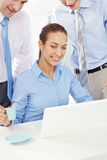 Watching presentation in office Stock Image