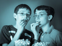 Watching a scary movie royalty free stock image