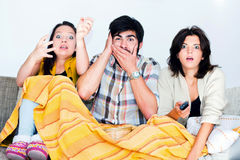 Watching scary movies Royalty Free Stock Photography
