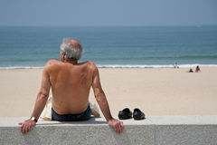 Watching Sea. Man watching sea in beach Stock Photos