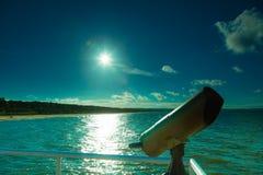 Watching sea trought telescope binoculars on pier Royalty Free Stock Image