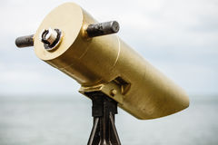 Watching sea trought telescope on a turistic tower Royalty Free Stock Photo