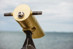 Watching sea trought telescope on a turistic tower Stock Photo