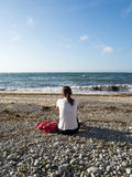Watching the sea. Woman watching the horizon and the sea on a wild beach. Asturias. North of Spain Stock Photography