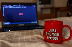 Watching series with a cup of tea. Just one more episode. Millennial concept stock photography