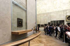 Watching & Shooting the Mona Lisa. Tourists and Louvre museum visitors gather around the famous Mona Lisa to watch it and take photos of it. Leonardo Da Vinci Royalty Free Stock Image