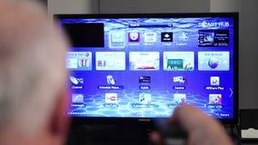 Watching Smart tv stock video