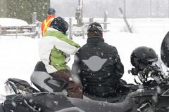 Watching the snowmobile races Royalty Free Stock Images