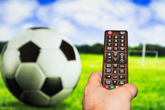 Watching soccer / football game on modern tv, with a close-up of Royalty Free Stock Images
