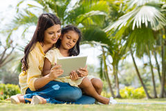 Watching something on the digital tablet Royalty Free Stock Images