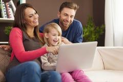 Watching something on laptop Royalty Free Stock Photos