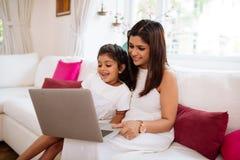 Watching something on laptop Stock Photo