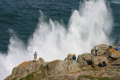 Watching a spectacular sea spray. Sennen, Cornwall, UK Stock Photography