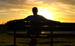 Watching the sun set 2 Stock Image
