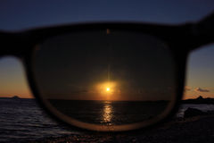 Watching through sunglasses Royalty Free Stock Image