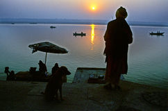 Watching Sunrise on Ganges at Varanasi. A monk in looking at the sun rises on the other side of river Ganges at varanasi Stock Photography