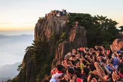 Watching Sunrise at Mt. Huangshan royalty free stock image