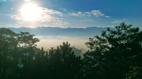 Watching the sunrise over the East Rift Valley in Hualien, Taiwan. As the sun rises over the clouded mountains of Hualien, the thick fog begins to dissipate stock photo