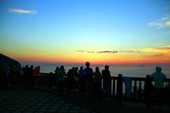 Watching the sunrise at the top of the mountain royalty free stock photo