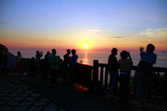 Watching the sunrise at the top of the mountain royalty free stock photography