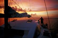 Watching the sunset. Sunset on board a catamaran, Seychelles Stock Photo