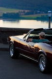 Watching sunset. Man sitting in antique car watching sunset over Columbia river Stock Photos