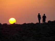Watching the sunset. Couple watching the sunset in Punta Nati Menorca Royalty Free Stock Photos