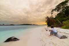 Watching sunset on the beach Stock Image