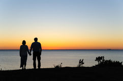 Watching sunset hand in hand Royalty Free Stock Photos