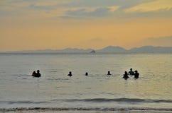 Watching the sunset. Krabi thailand sea people shadow Stock Image