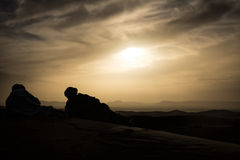 Watching sunset in the Moroccan desert Royalty Free Stock Photo