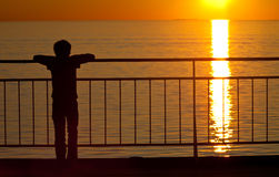 Watching the sunset. Sweden. Boy watching the sunset. Sea Royalty Free Stock Photo