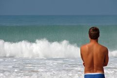 Watching surf. A guy watching surf Royalty Free Stock Image